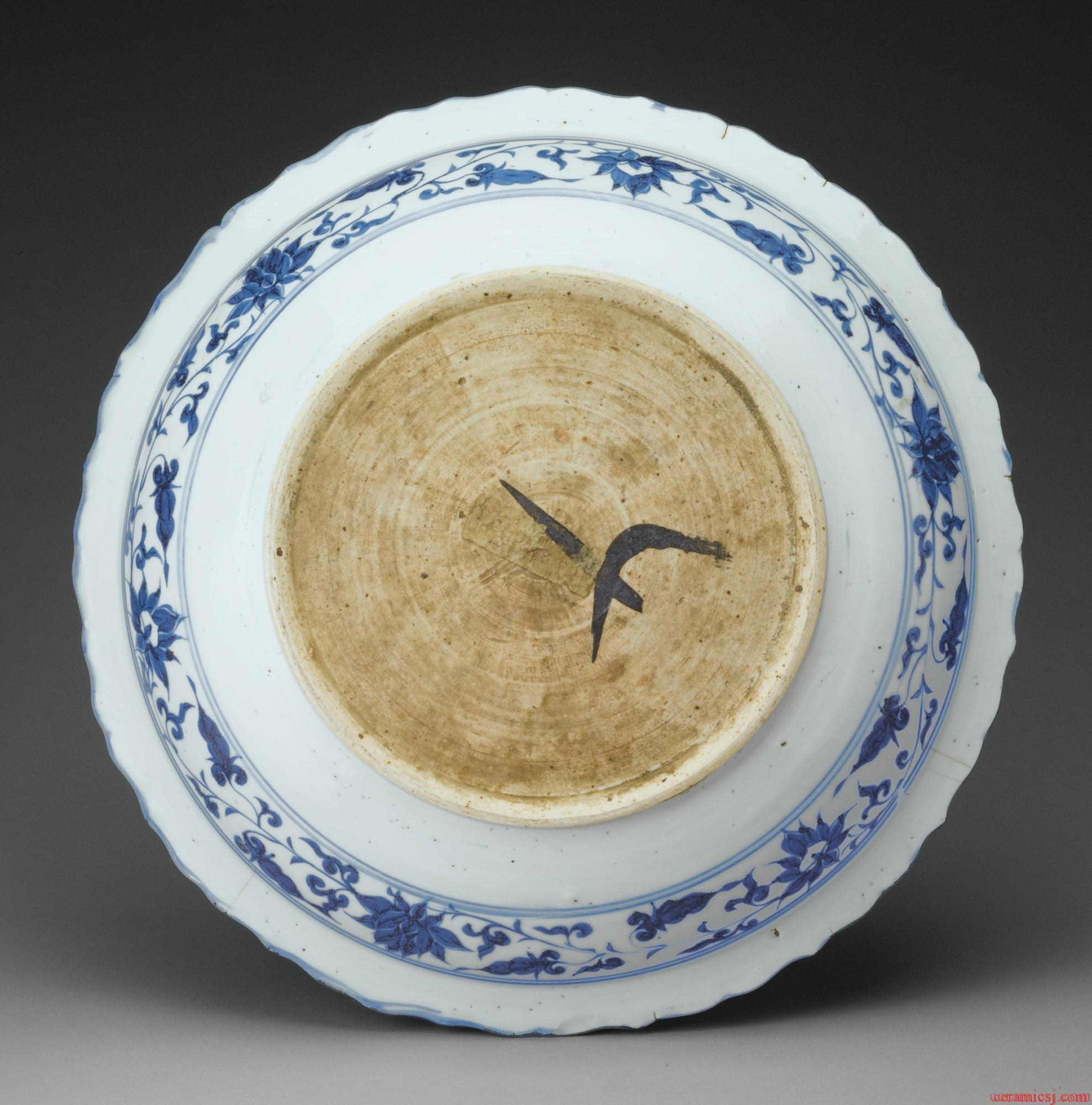 Sothebys:PROPERTY FROM A PRIVATE COLLECTION A RARE MOLDED BLUE AND WHITE BARBED RIM DISH YUAN DYNASTY, 14TH CENTURY Estimate   200,000 — 300,000  USD  LOT SOLD.4,197,000 USD